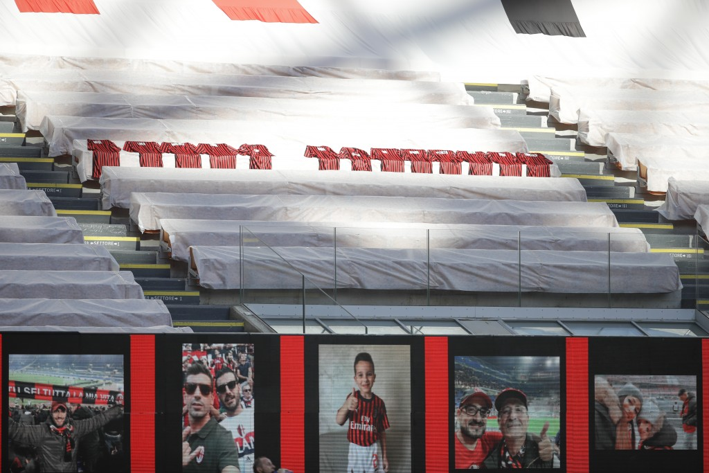 Jerseys to honor the victims of COVID-19 are placed in the stands during the Serie A soccer match between AC Milan and Roma, at the San Siro Stadium i...