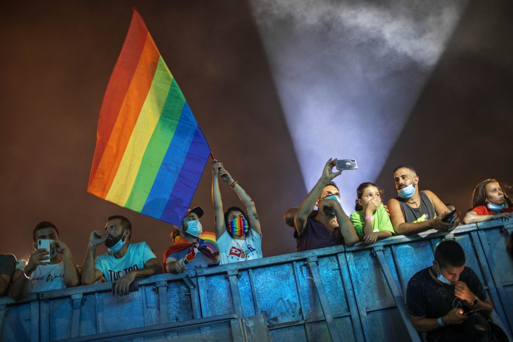 Hundreds of LGBT members and supporters attend a gay pride rally under strict health restrictions due to the coronavirus outbreak in Tel Aviv, Israel,...