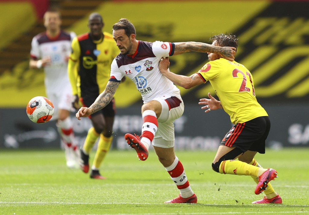 Southampton's Danny Ings, left, gets past Watford's Kiko Femenia during the English Premier League soccer match between Watford and Southampton at the...