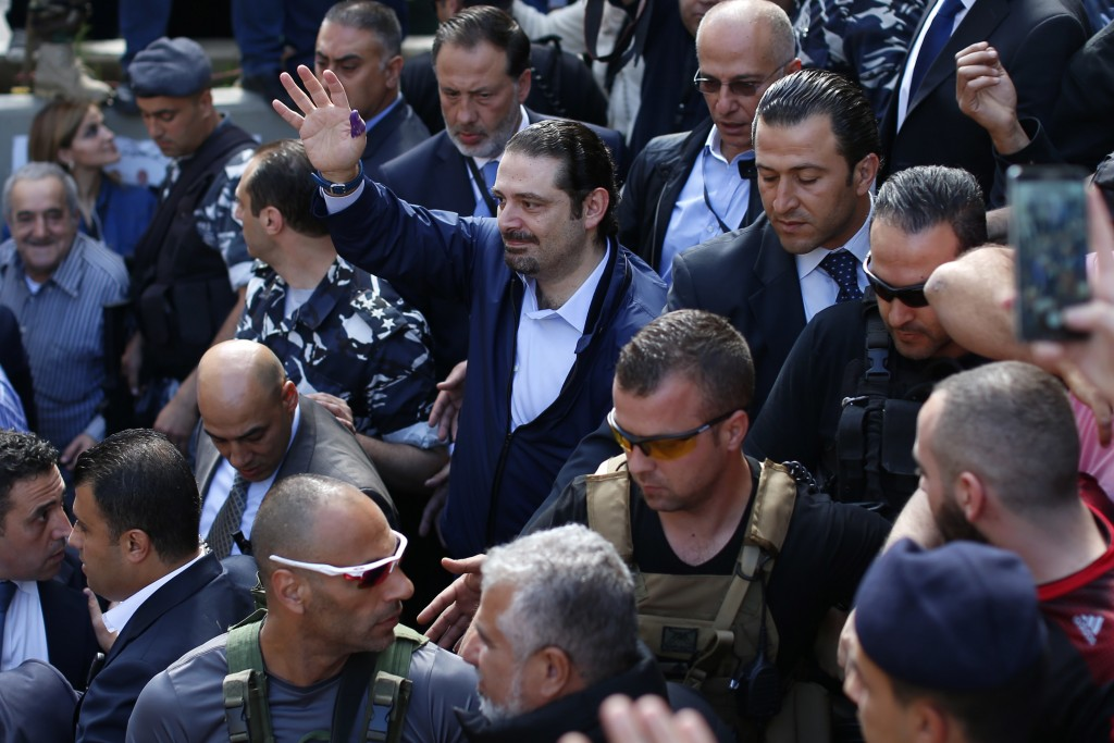 FILE - In this Sunday, May 8, 2016 file photo, Former Lebanese Prime Minister Saad Hariri, center, leader of Lebanon's parliamentary majority, waves t...