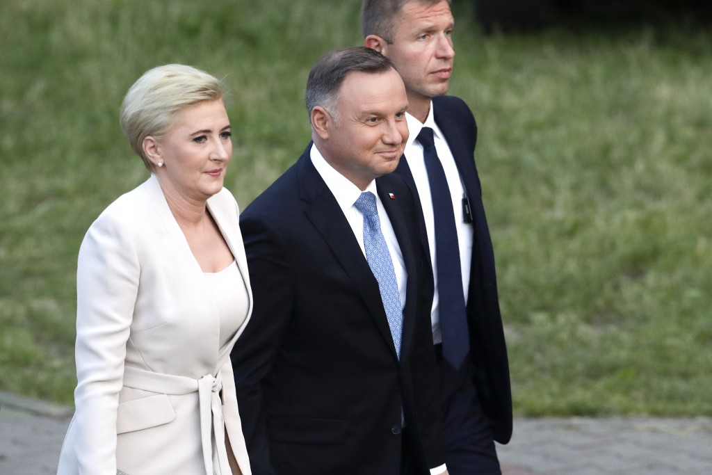 President Andrzej Duda and his wife Agata Kornhauser-Duda arrive shortly before the end of voting in the presidential election in Lowicz, Poland, Sund...