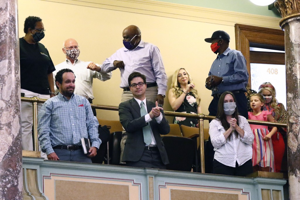 Observers in the gallery applaud after the Senate voted to change the Mississippi flag Sunday, June 28, 2020, at the Capitol in Jackson, Miss. Mississ...
