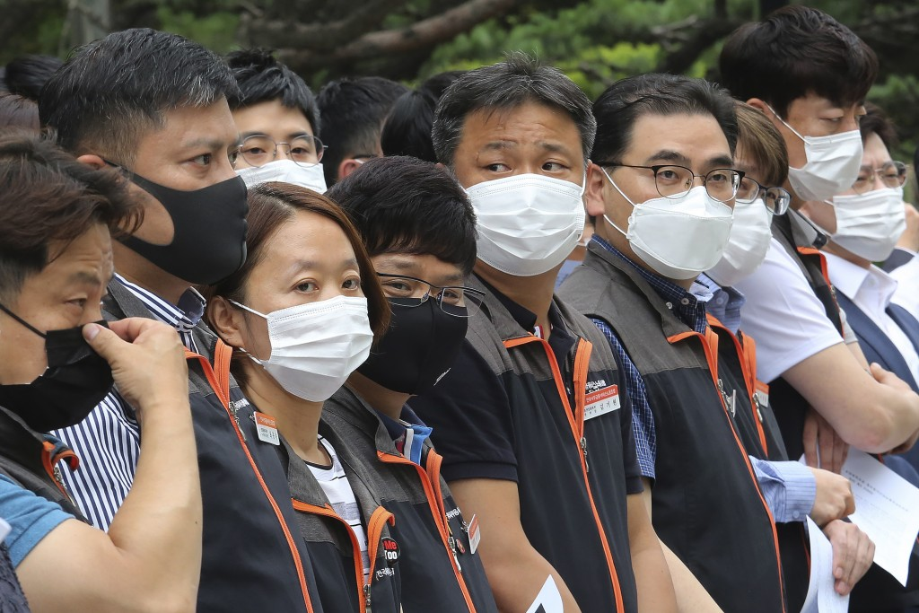 Financial union members wearing face masks to help protect against the spread of the new coronavirus attend a rally against government's financial pol...