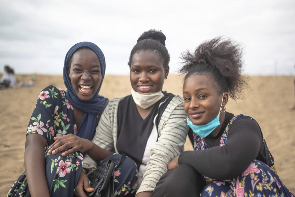 Young women pose for a portrait while spending time at a reopened beach after lockdown measures were lifted in Sale, Morocco, Friday, June 26, 2020. I...
