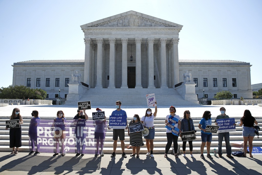 Anti-abortion protesters wait outside the Supreme Court for a decision, Monday, June 29, 2020 in Washington on the Louisiana case, Russo v. June Medic...
