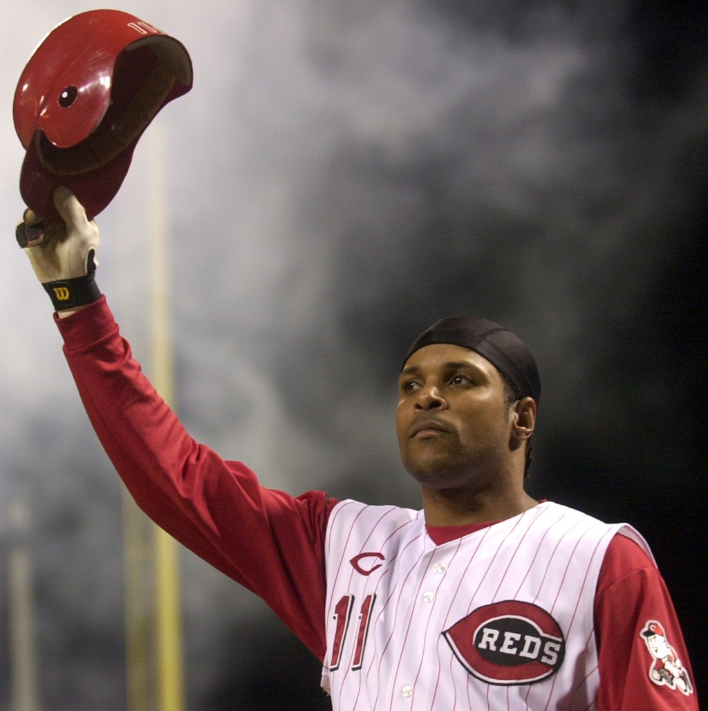 FILE - In this July 28, 2004, file photo, Cincinnati Reds' Barry Larkin takes a curtain call after hitting a pinch-hit grand slam off St. Louis Cardin...