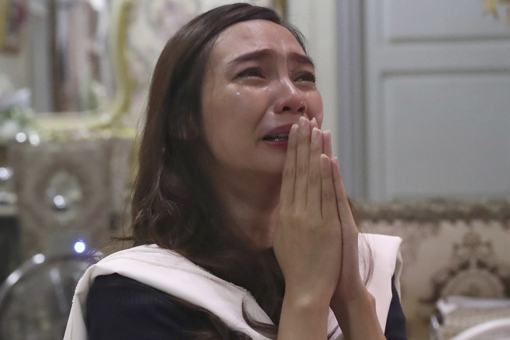 Tri Novia Septiani cries during an online memorial service marking the 40th day since the death of her fiance Dr. Michael Robert Marampe who died of C...