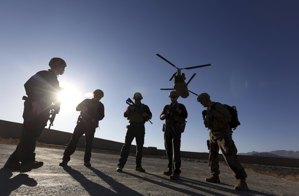 FILE - In this Nov. 30, 2017 file photo, American soldiers wait on the tarmac in Logar province, Afghanistan. Top officials in the White House were aw...