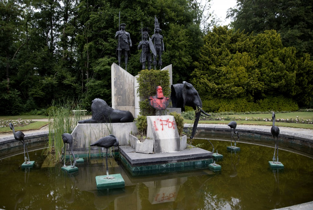 FILE - In this June 9, 2020 file photo, the bust of Belgium's King Leopold II is smeared with paint and graffiti on the grounds of the Royal Museum fo...