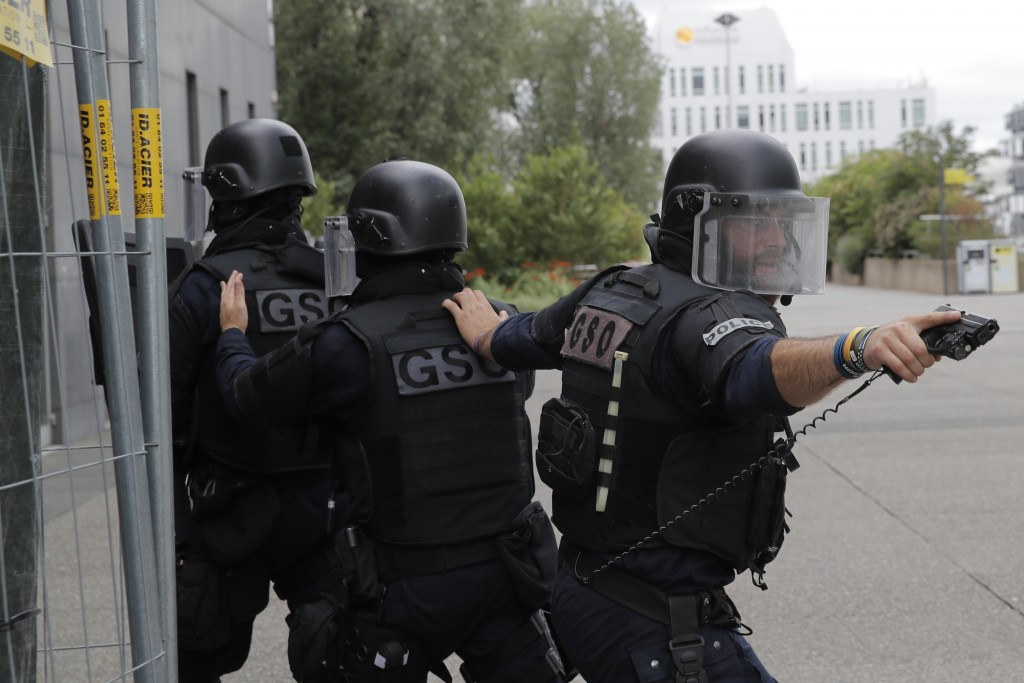 French police officers in the business district of La Defense Tuesday, June 30, 2020 outside Paris. Paris police said that police checks are being car...
