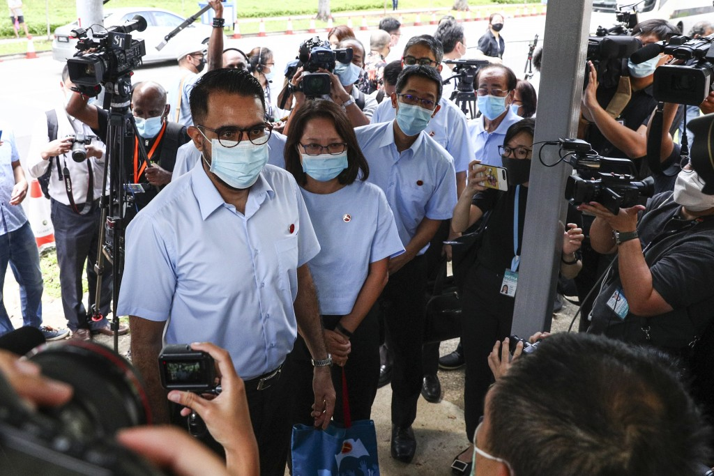 Workers' Party Secretary-General Pritam Singh, left, and Chairman Sylvia Lim, second left, arrive at a nomination center with their team to submit the...