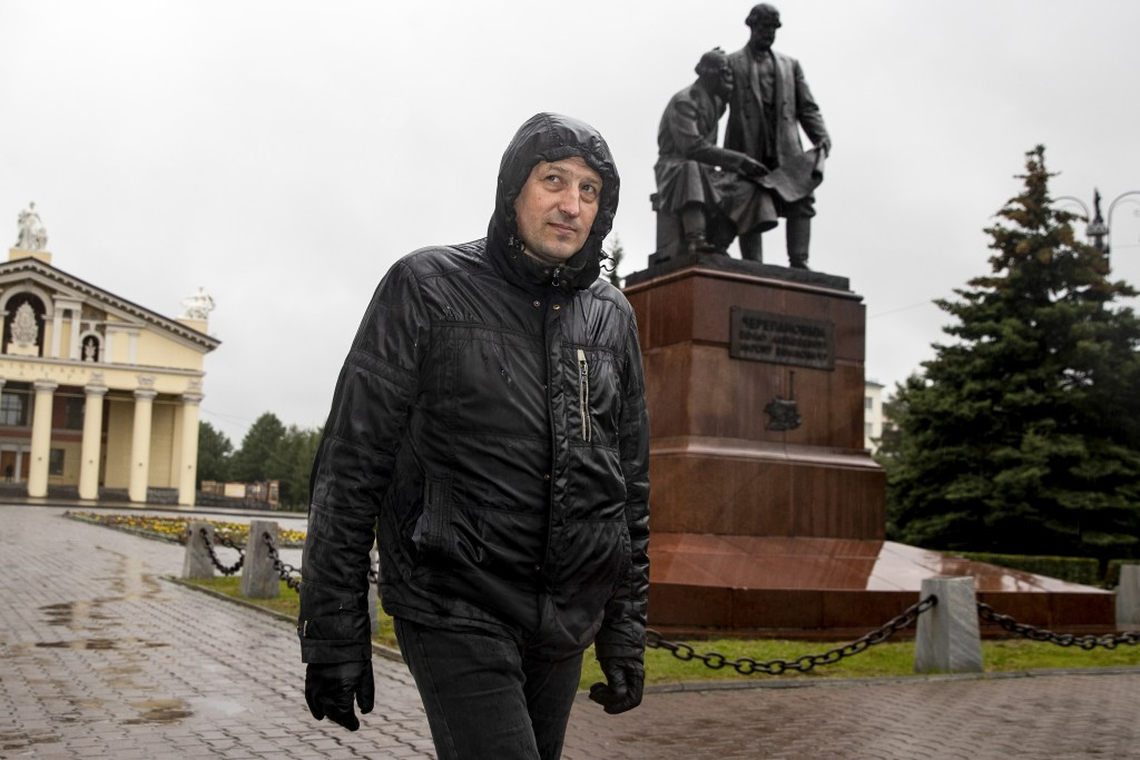 In this photo taken on Sunday, June 28, 2020, Nikolay Nemytov, a 43-year-old worker at Russian Railways, walks past a monument to local inventors and ...