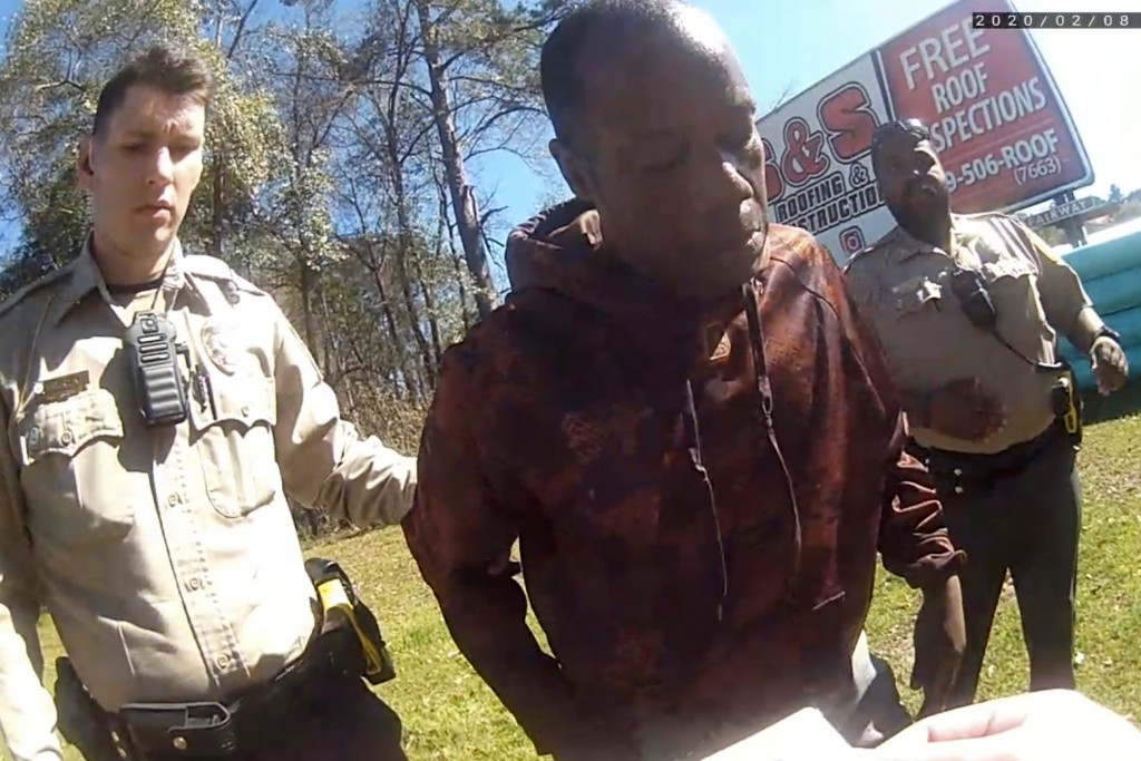 In this still image from body camera video released by the Valdosta police, Antonio Arnelo Smith, center, recovers after being slammed face-first to t...