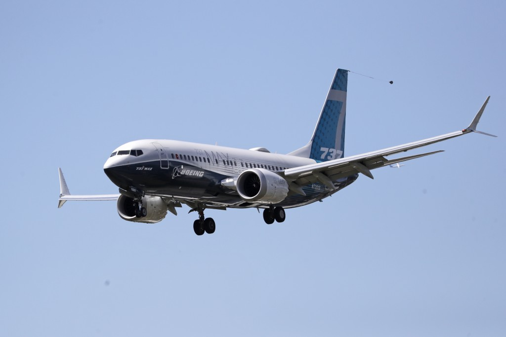 A Boeing 737 MAX jet heads to a landing at Boeing Field following a test flight Monday, June 29, 2020, in Seattle. The jet took off from Boeing Field ...