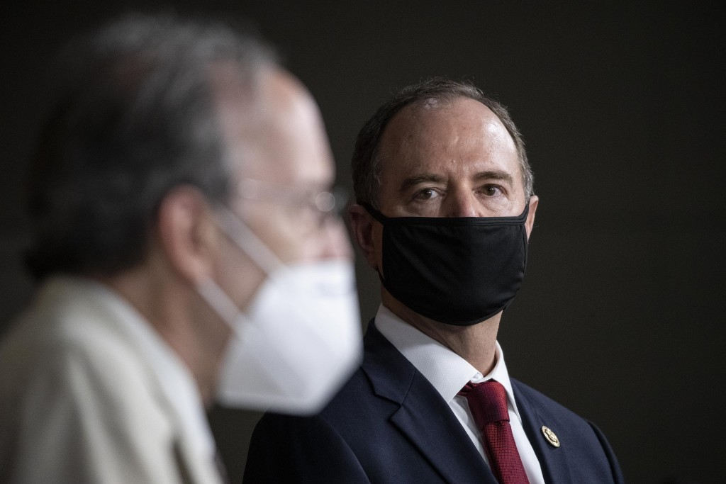 Rep. Adam Schiff, D-Calif., Chairman of the House Intelligence Committee, right, listens as Rep. Eliot Engel, D-N.Y., Chairman of the House Committee ...