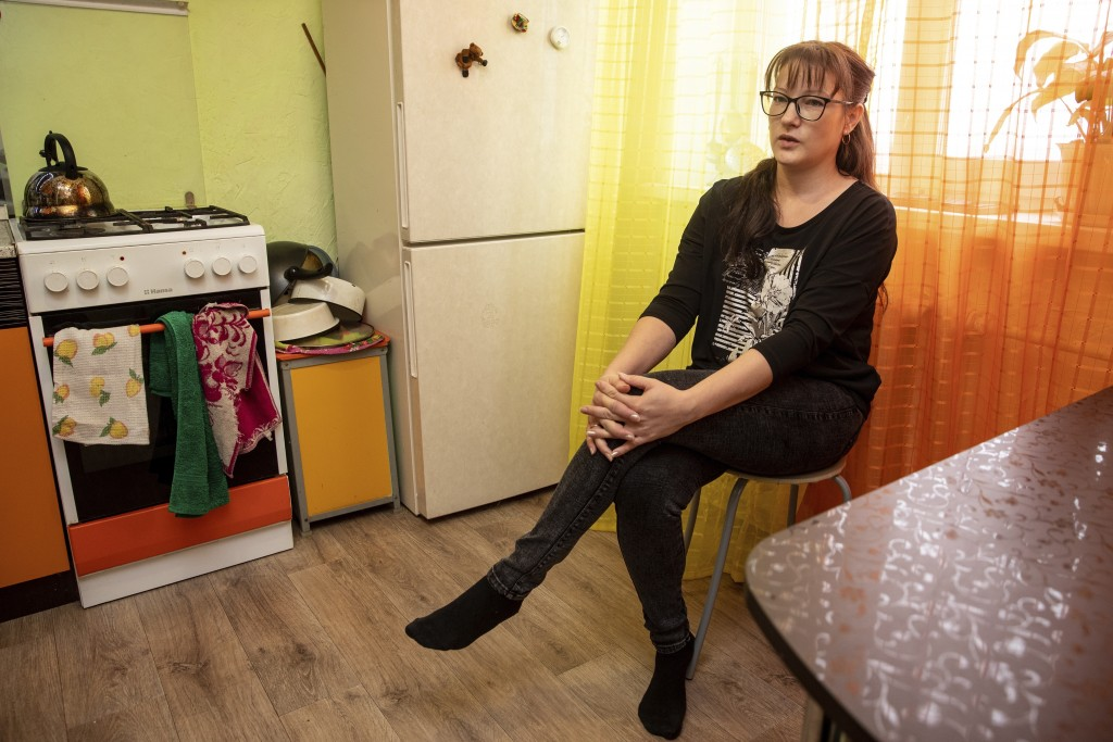 In this photo taken on Sunday, June 28, 2020, Nadezhda Zhuravlyova, 36, a local activist, speaks during an interview with The Associated Press in Nizh...