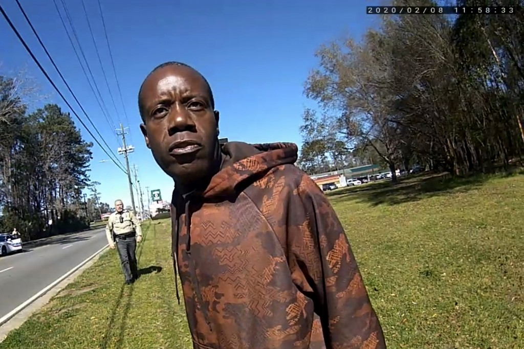 In this still image from a body camera video released by the Valdosta police, Antonio Arnelo Smith speaks to an officer as Sgt. Billy Wheeler approach...