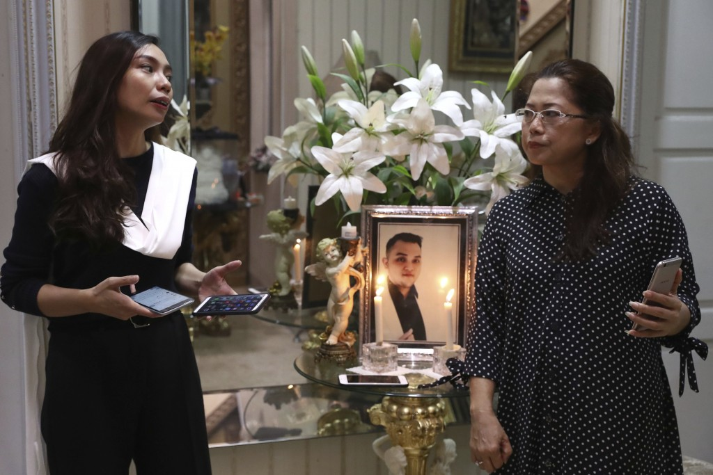 Fiance Tri Novia Septiani, left, and mother Herlina Simbala of Dr. Michael Robert Marampe attend an online memorial service to mark the 40th day since...