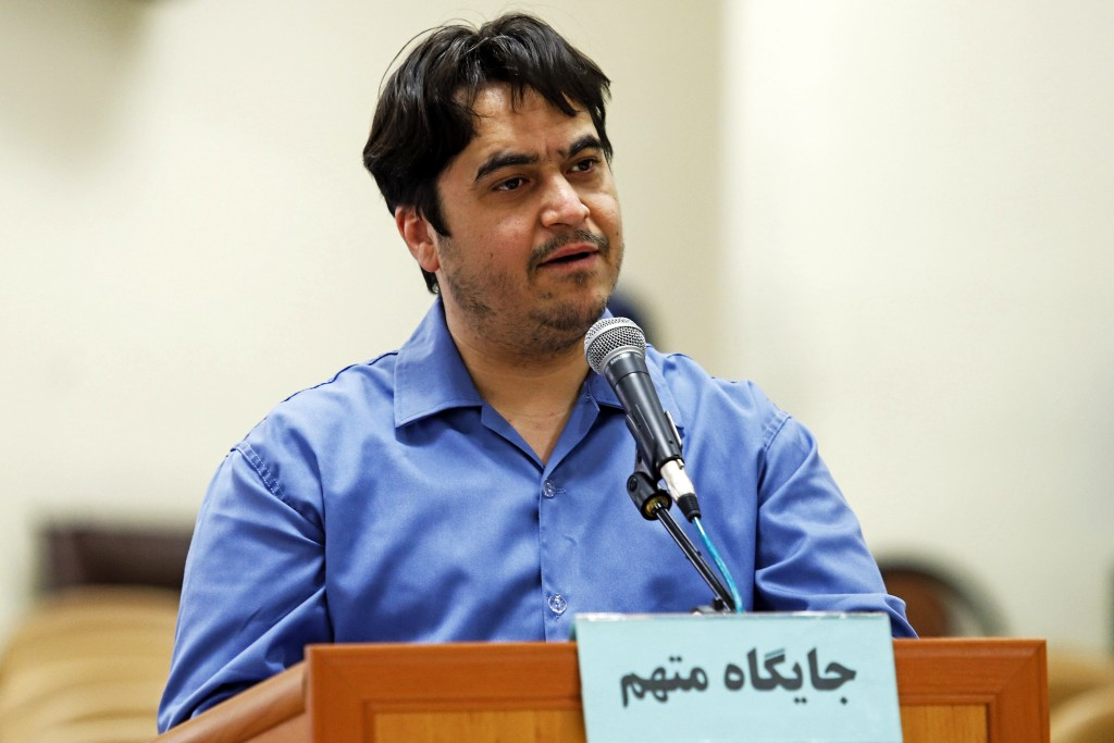 In this June 2, 2020 photo, journalist Ruhollah Zam speaks during his trial at the Revolutionary Court, in Tehran, Iran. Iran. The judiciary spokesman...