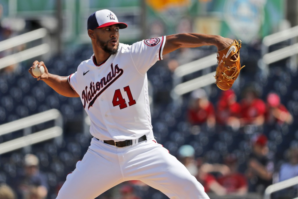 FILE - In a  Monday, March 2, 2020 file photo, Washington Nationals pitcher Joe Ross throws during the first inning of a spring training baseball game...