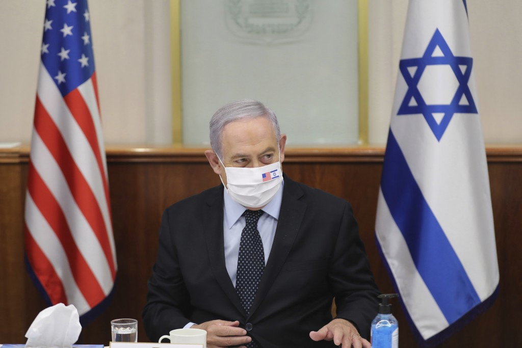 Israeli Prime Minister Benjamin Netanyahu attends a press briefing with US special envoy for Iran, Brian Hook, while wearing a face mask to help preve...
