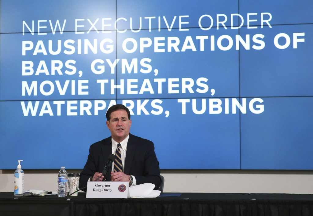 Arizona Gov. Doug Ducey announces a new executive order in response to the rising COVID-19 cases in the state, during a news conference in Phoenix on ...