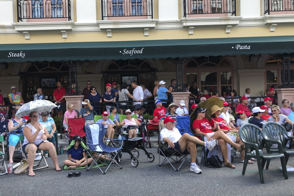 FILE - In this Oct. 3, 2019 file photo, supporters of President Donald Trump wait outside in a town square in The Villages, Fla., before an appearance...