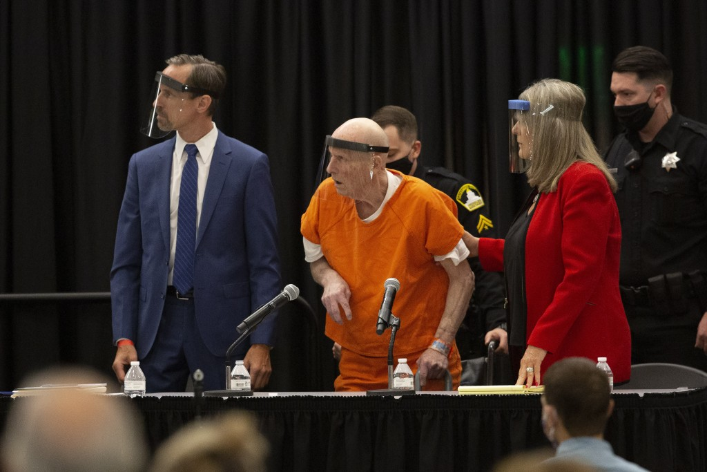 Joseph James DeAngelo, center, charged with being the Golden State Killer, his helped up by his attorney, Diane Howard, as Sacramento Superior Court J...