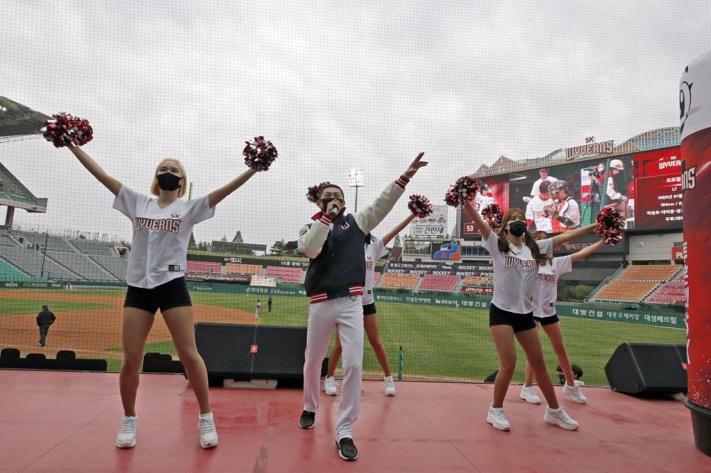 FILE - In this May 5, 2020, file photo, SK Wyverns' cheerleaders cheer for their team during a baseball game against Hanwha Eagles in Incheon, South K...