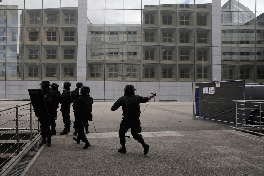 French police officers patrol in the business district of La Defense Tuesday, June 30, 2020 outside Paris. Paris police said that police checks are be...