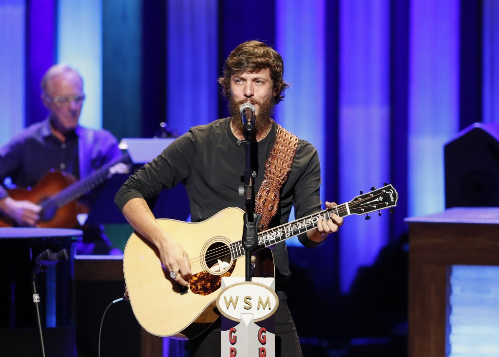 "FILE - In this July 16, 2019 file photo, Chris Janson performs at ""Luke Combs Joins the Grand Ole Opry Family"" at the Grand Ole Opry in Nashville, Ten..."