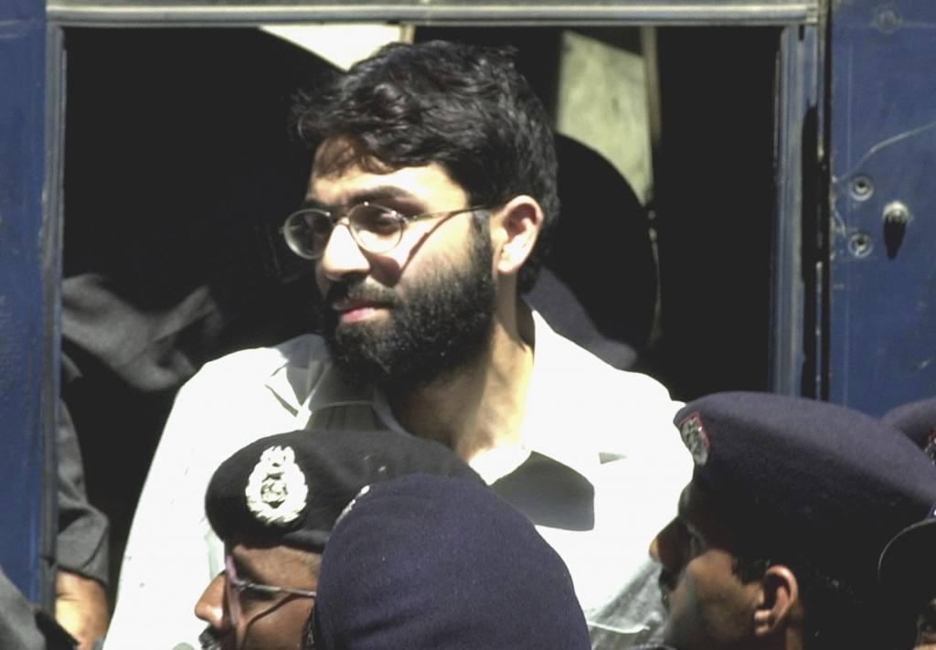 FILE - In this March 29, 2002, file photo, Ahmed Omar Saeed Sheikh arrives at a court in Karachi, Pakistan. A ruling by Pakistan's Supreme Court on Mo...