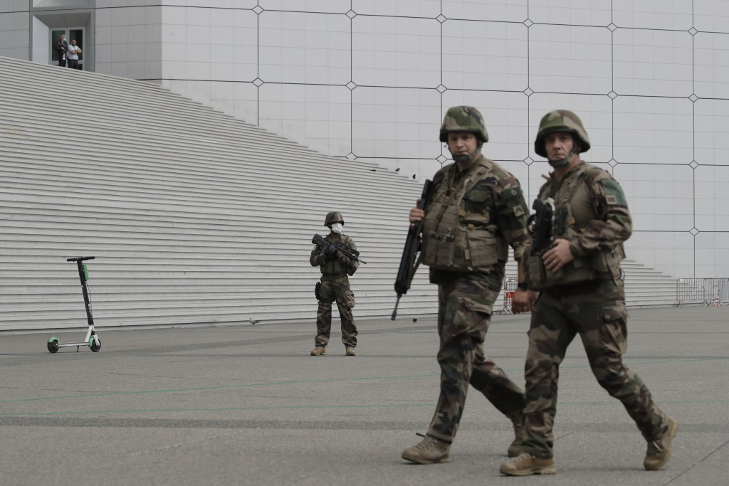 Soldiers patroli in the business district of La Defense Tuesday, June 30, 2020 outside Paris. Paris police said that police checks are being carried o...