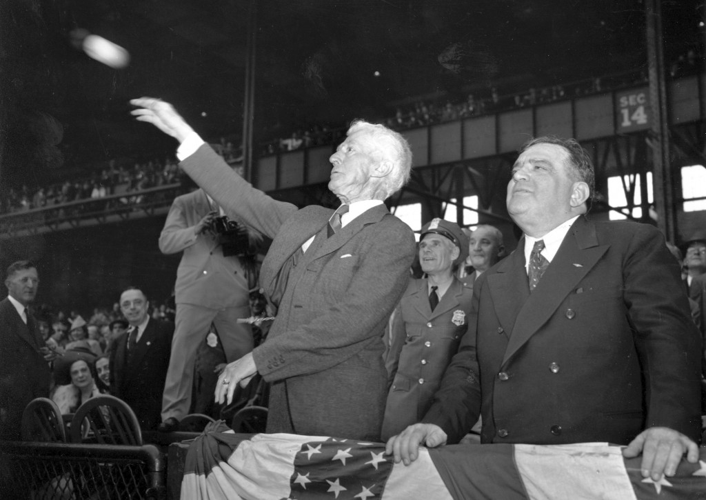 FILE - In this Oct. 1, 1941, file photo, Kenesaw Mountain Landis, baseball commissioner, throws out the first ball, formally opening the 1941 World Se...
