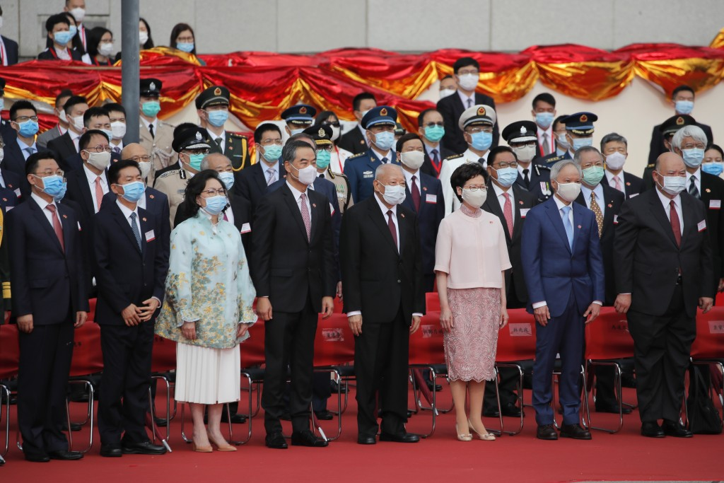 Hong Kong Chief Executive Carrie Lam, third from right in front, and former chief executives Tung Chee-hwa, fourth from right, and Leung Chun-ying, fi...