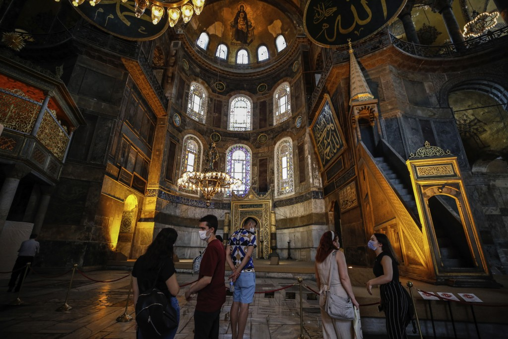 People visit the Byzantine-era Hagia Sophia, one of Istanbul's main tourist attractions in the historic Sultanahmet district of Istanbul on Thursday, ...