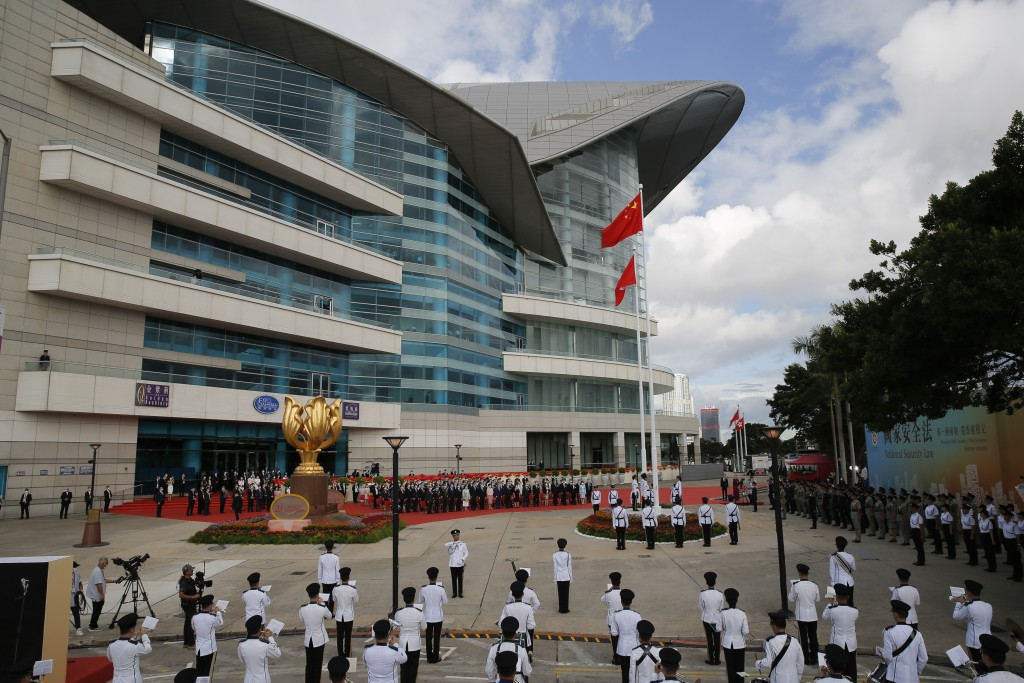 A flag raising ceremony is held at the Golden Bauhinia Square to mark the anniversary of the Hong Kong handover to China in Hong Kong, Wednesday, July...
