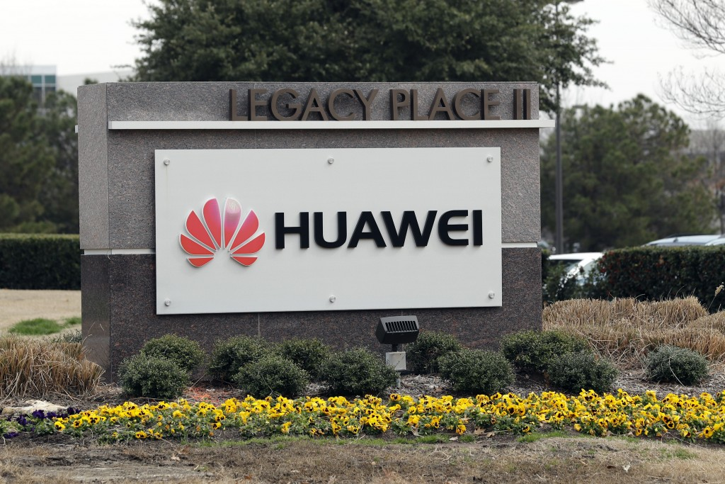 FILE - In this March 7, 2019, file photo, a sign is displayed outside the Huawei Technologies Ltd. business location in Plano, Texas. China on Wednesd...