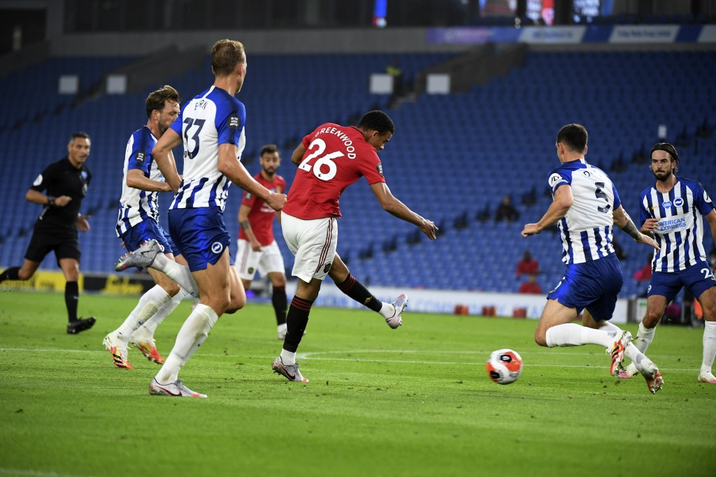 Manchester United's Mason Greenwood, center, scores the opening goal of his team during the English Premier League soccer match between Brighton & Hov...