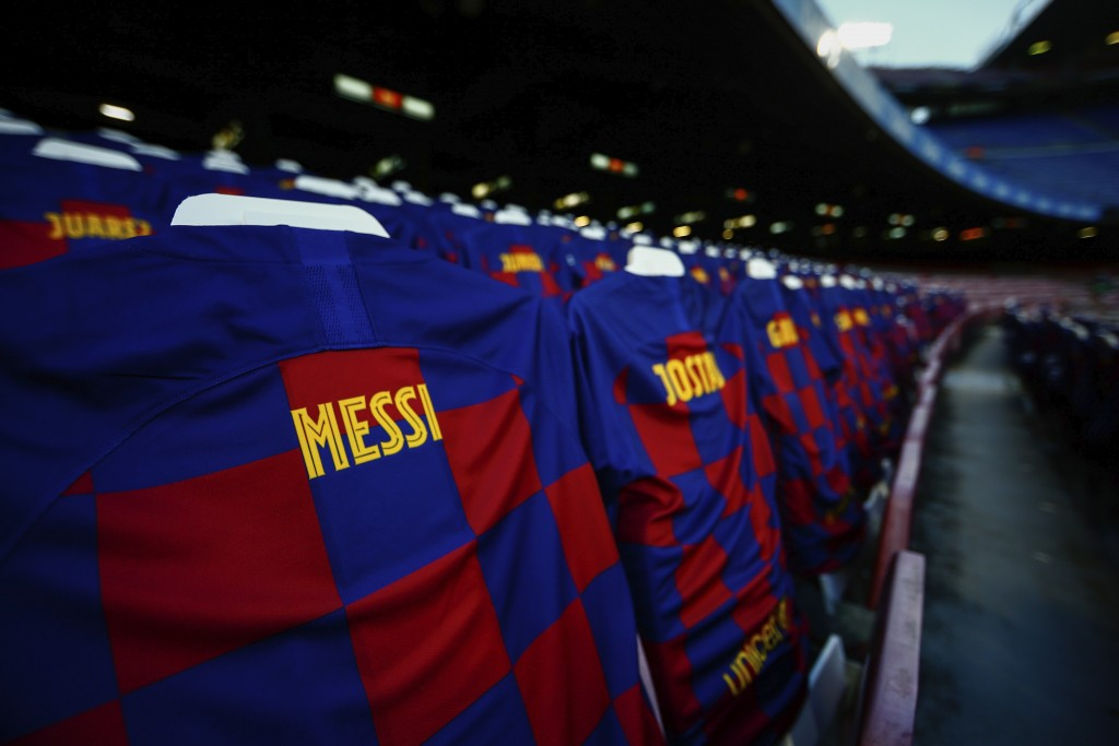 FC Barcelona soccer shirts are displayed at the Camp Nou stadium stands prior the Spanish La Liga soccer match between FC Barcelona and Atletico Madri...