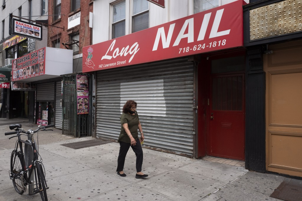 A Brooklyn nail salon remains closed during the coronavirus pandemic, Tuesday, June 30, 2020, in New York. New York City may begin Phase 3 reopening a...