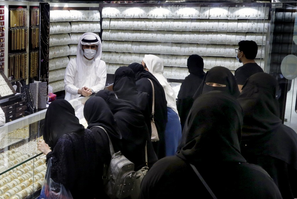Saudis buy jewels at the gold market a day before the expected increase of VAT from 5% to15%, in Jiddah, Saudi Arabia, Tuesday, June 30, 2020. (AP Pho...