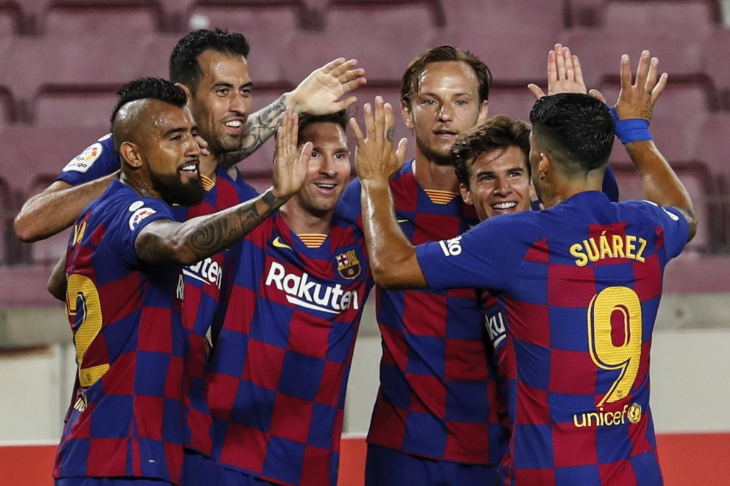 FC Barcelona players celebrate their opening goal during the Spanish La Liga soccer match between FC Barcelona and Atletico Madrid at the Camp Nou sta...