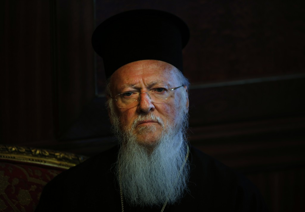 FILE - In this Monday, May 11, 2015 file photo, Ecumenical Patriarch Bartholomew I, the spiritual leader of the world's Orthodox Christians, listens d...