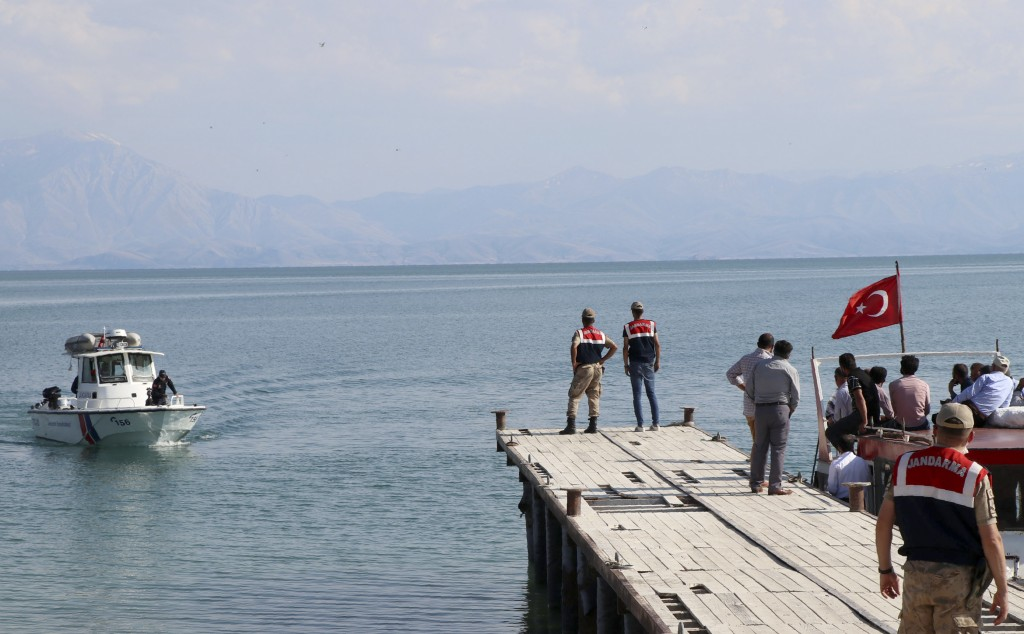 A paramilitary boat searches for people in Lake Van, in eastern Turkey, Wednesday, July 1, 2020. Up to 60 migrants may have been trapped in a boat tha...