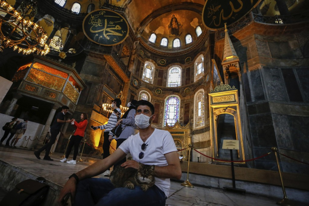 People visit the Byzantine-era Hagia Sophia, one of Istanbul's main tourist attractions in the historic Sultanahmet district of Istanbul, Thursday, Ju...