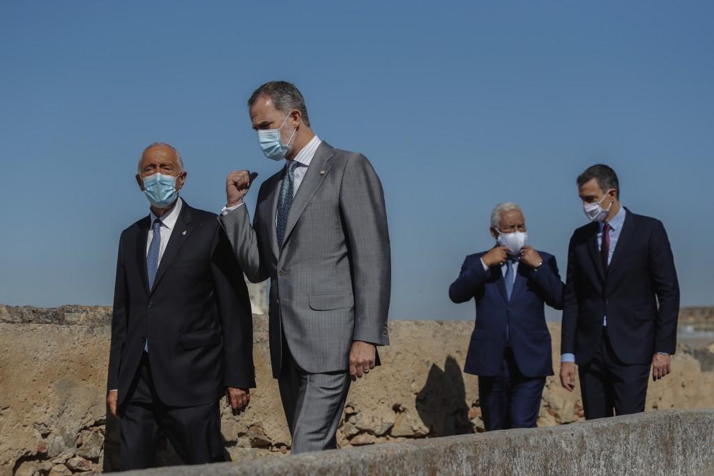 From left to right: Portugal's President Marcelo Rebelo de Sousa, Spain's King Felipe VI, Portugal's Prime Minister Antonio Costa and Spain's Prime Mi...