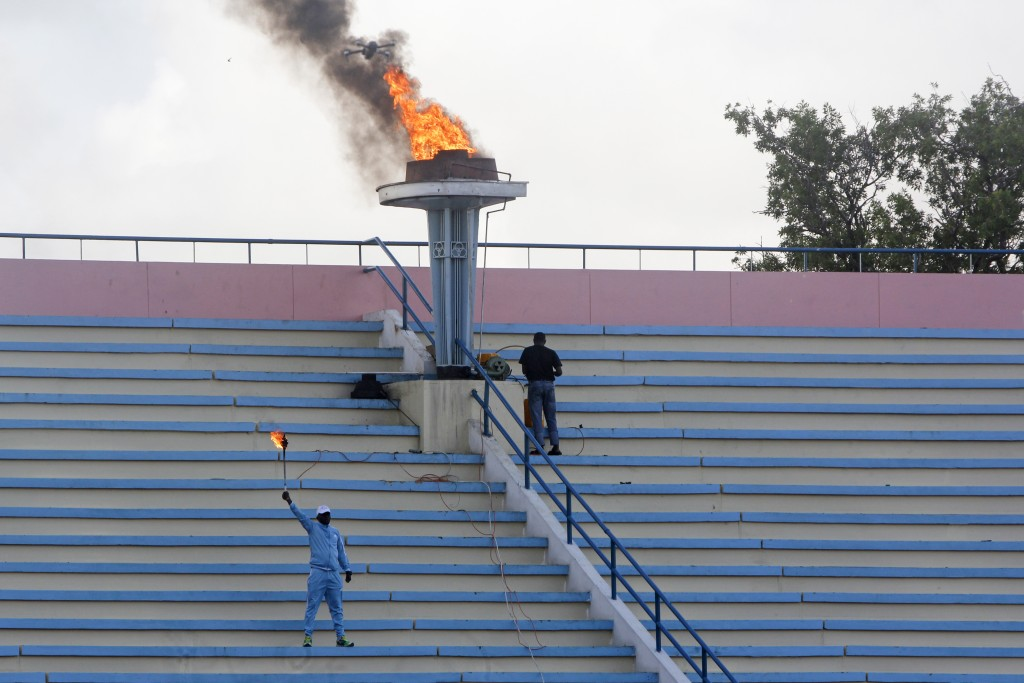 A ceremonial torch is lit to mark the reopening of the stadium in Mogadishu, Somalia Tuesday, June 30, 2020. At least three mortar blasts struck the M...