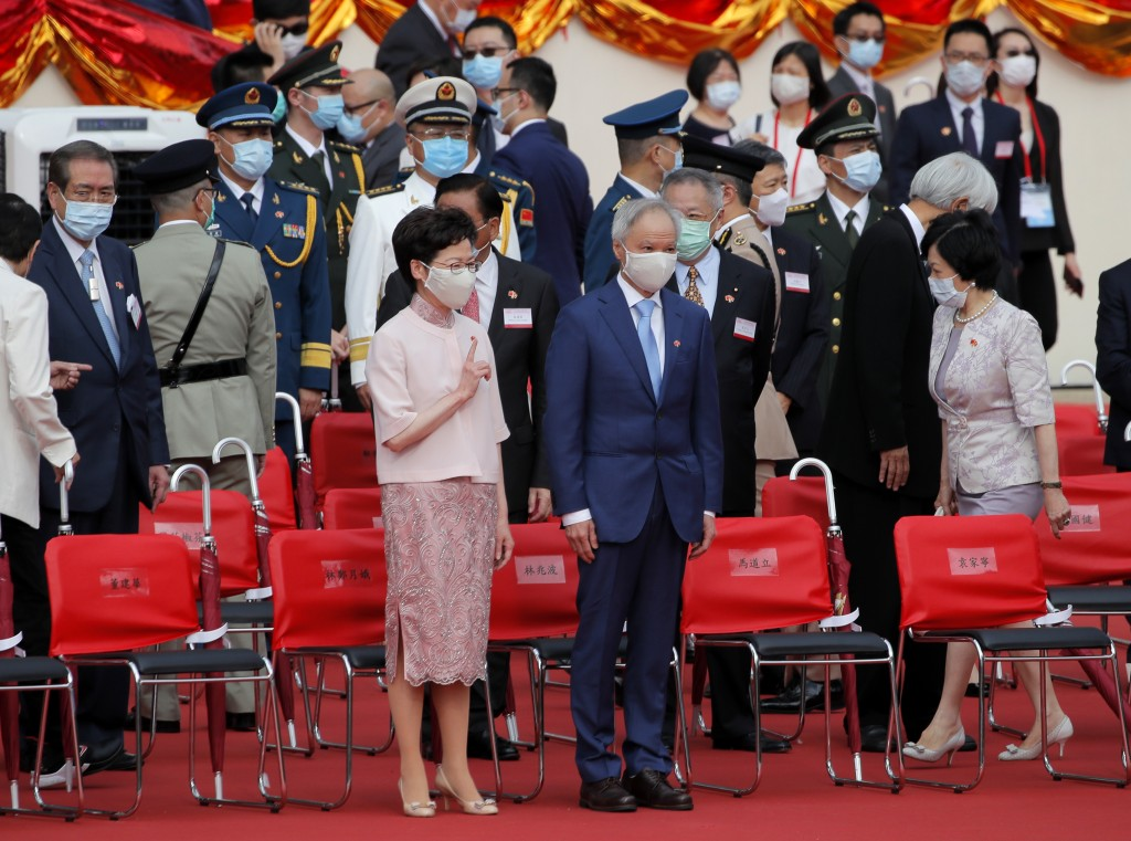 Hong Kong Chief Executive Carrie Lam, left, and her husband Lam Siu-por attend the flag raising ceremony is held at the Golden Bauhinia Square to mark...