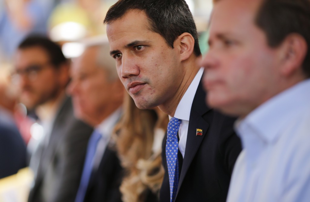 FILE - In this Feb. 21, 2020 file photo, opposition leader Juan Guaido meets with union workers and supporters in Caracas, Venezuela. A British judge ...